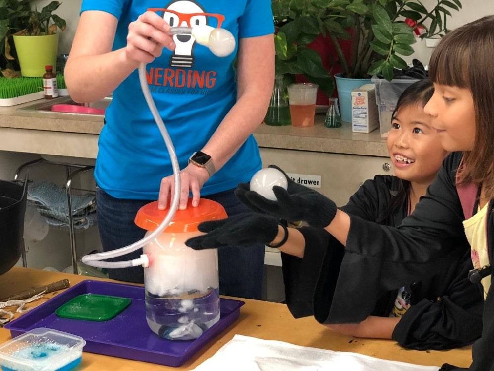 kids holding carbon dioxide bubbles